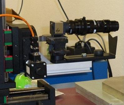 Sistema motorizzato di precisione con camera digitale per monitoraggio ottico